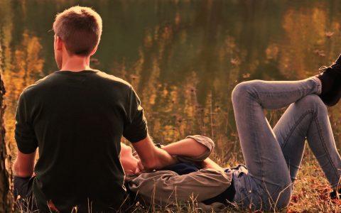 Couple laying in a field - Estrogen
