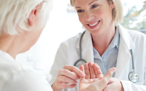 Doctor examining patient with arthritis